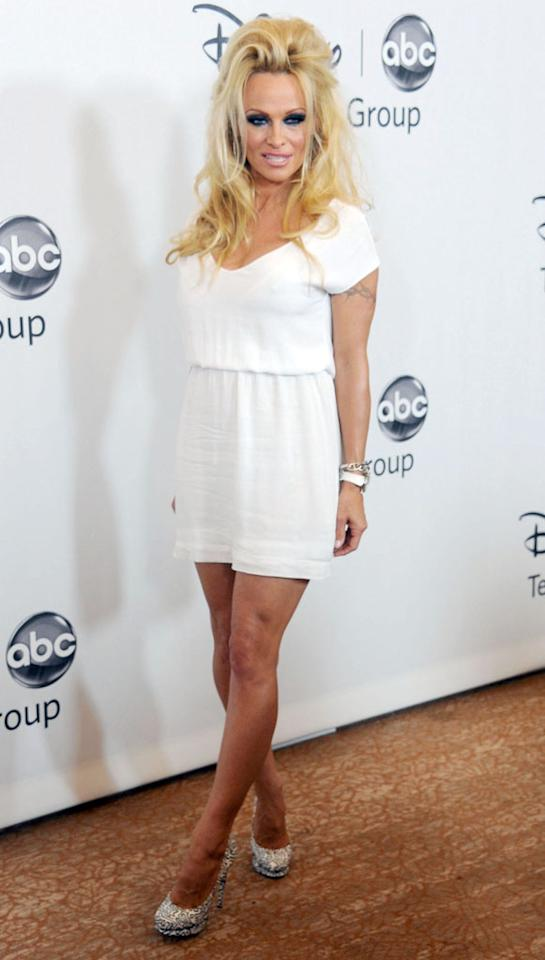 "Pamela Anderson (""Dancing With the Stars: All-Stars"") arrives at the Disney/ABC Television Group Summer 2012 Press Tour Party at The  Beverly Hilton Hotel on July 27, 2012 in Beverly Hills, California."