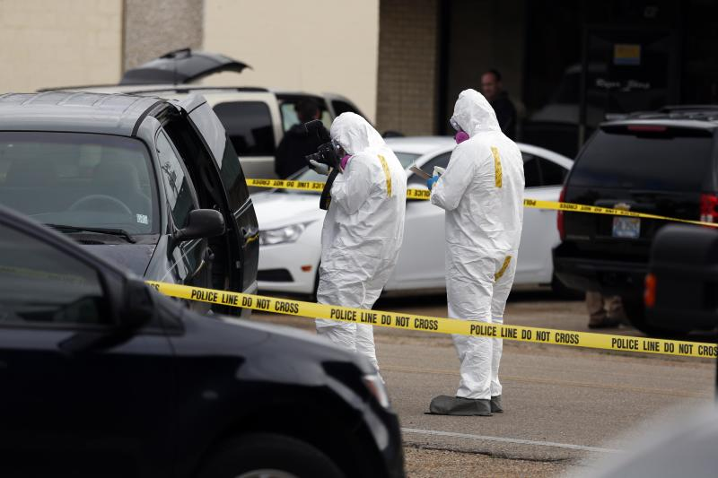 Federal authorities inspect and photograph the minivan driven by Everett Dutschke near the site of a martial arts studio he once operated, Wednesday, April 24, 2013 in Tupelo, Miss., in connection with the investigation into poisoned letters mailed to President Barack Obama and others. Dutschke has not been arrested or charged. (AP Photo/Rogelio V. Solis)