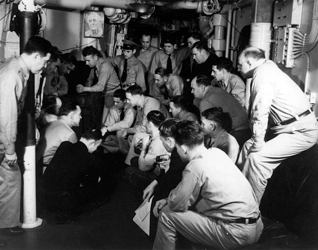 <p>Ship's chief petty officers listen to the radio broadcast of President Franklin D. Roosevelt's address to Congress requesting a declaration of war against the Axis powers, Dec. 8, 1941. Note the photograph of Roosevelt on the bulkhead. (U.S. Navy/National Archives/Handout via Reuters) </p>