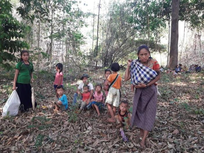 Escaping villagers from the Karen State are pictured in an unidentified location