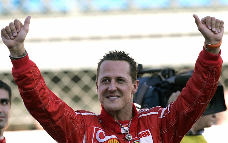 Former Ferrari driver Micheal Schumacher waves at fans. (Credit: Getty Images)