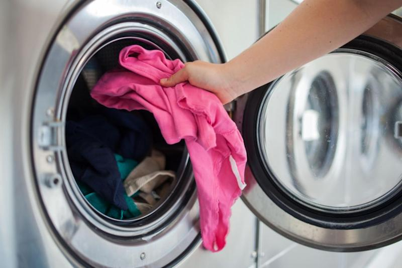 Experts recommend washing clothes before first wear. Photo: Getty