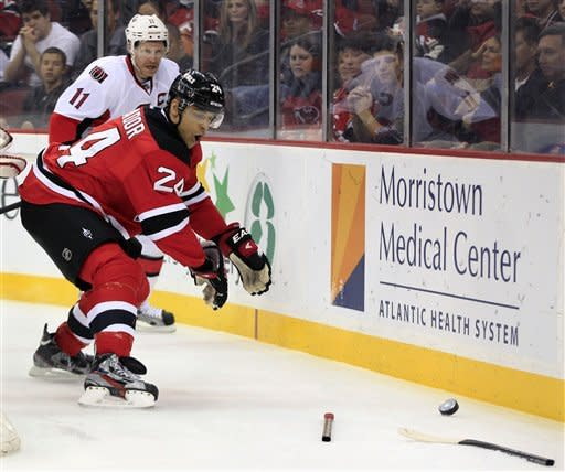 Ottawa Senators' Daniel Alfredsson (11), of Sweden, looks on as New Jersey Devils' Bryce Salvador (24) reacts as his stick is knocked from his hands and shattered during the first period of an NHL hockey game in Newark, N.J., Saturday, April 7, 2012. (AP Photo/Mel Evans)