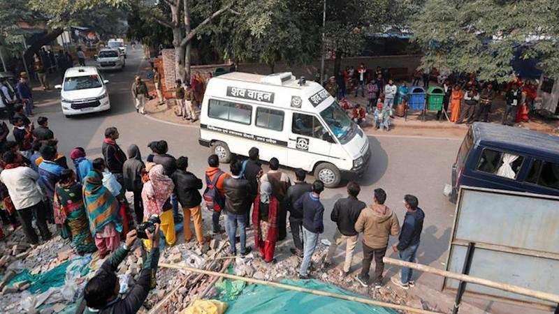 A hospital vehicle carries the body of a rape victim