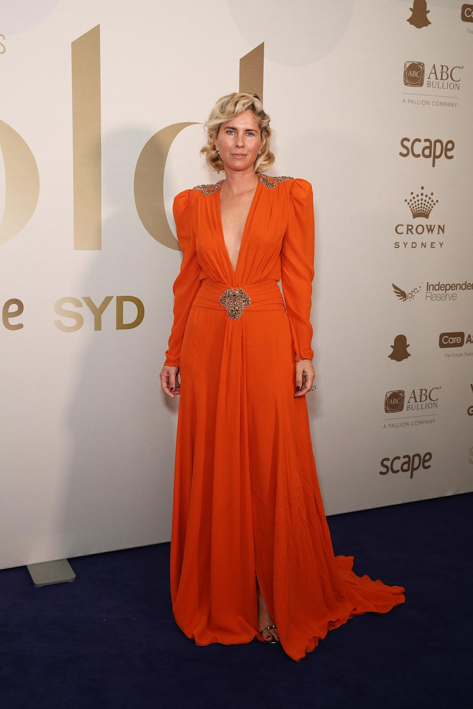 Sarah Jane Clarke wears a plunging orange gown at the Gold Dinner 2021 on June 10, 2021 in Sydney, Australia