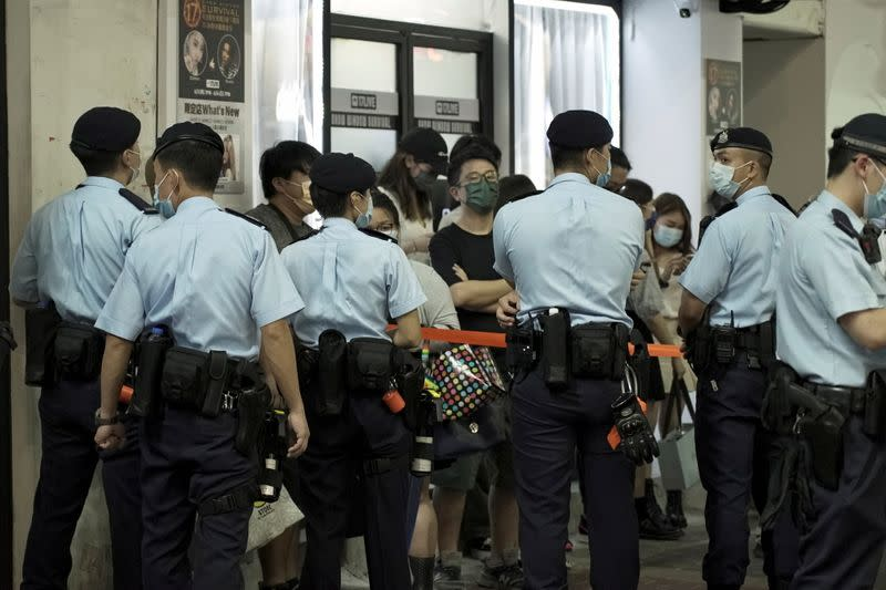 FILE PHOTO: Police officers stop and search residents at Mong Kok district in Hong Kong