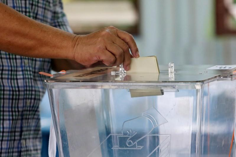 FILE PHOTO: A man casts his vote during the by-election in Port Dickson