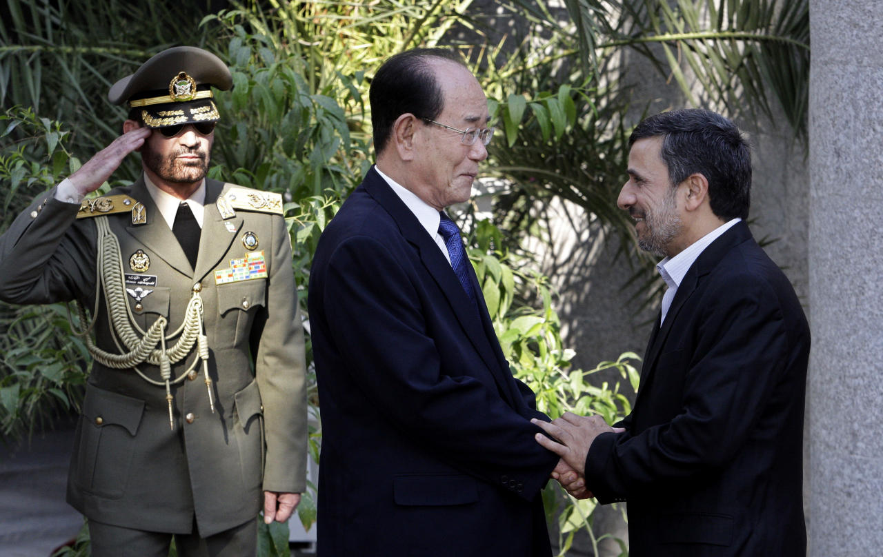 Iranian President Mahmoud Ahmadinejad, right, shakes hands with the president of the Presidium of North Korea's Supreme People's Assembly Kim Yong-nam, during an official welcoming ceremony in Tehran, Iran, Saturday, Sept. 1, 2012. Kim Yong-nam attended the Nonaligned Movement summit in Tehran on Thursday and Friday. (AP Photo/Vahid Salemi)