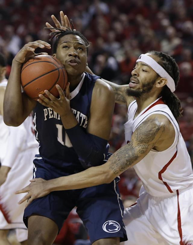Penn State's Brandon Taylor (10) is defended by Nebraska's Terran Petteway (5) in the first half of an NCAA college basketball game in Lincoln, Neb., Thursday, Feb. 20, 2014. (AP Photo/Nati Harnik)
