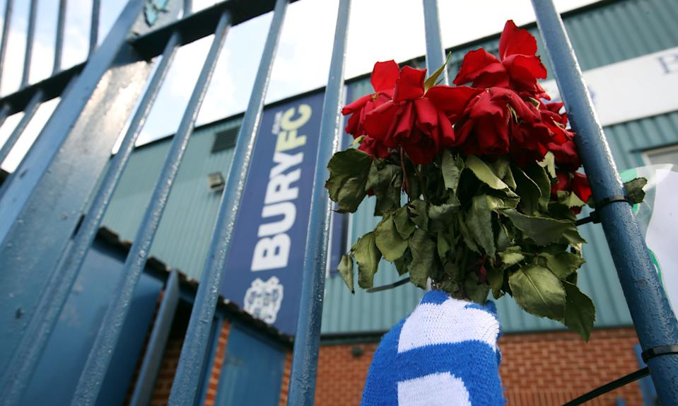 "Soccer Football - Bury - Gigg Lane, Bury, Britain - August 20, 2019   General view of flowers on the outside of the stadium   Action Images via Reuters/Carl Recine    EDITORIAL USE ONLY. No use with unauthorized audio, video, data, fixture lists, club/league logos or ""live"" services. Online in-match use limited to 75 images, no video emulation. No use in betting, games or single club/league/player publications.  Please contact your account representative for further details."
