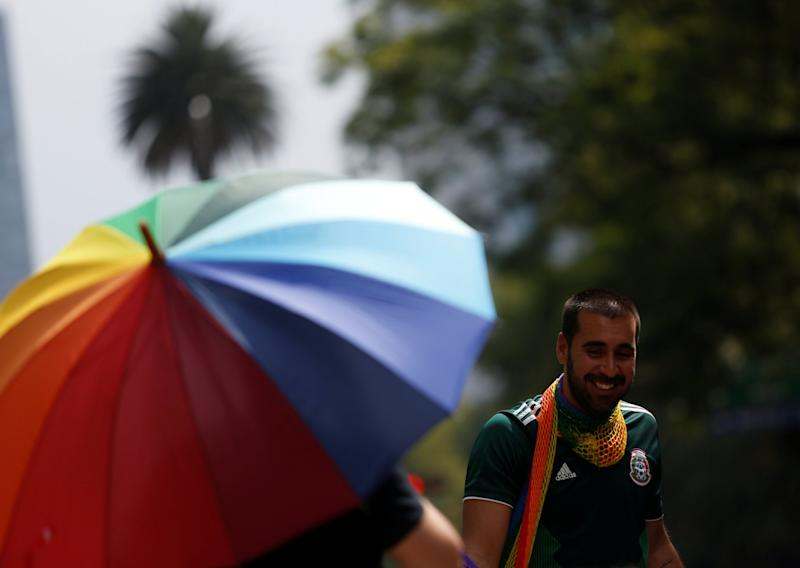 While some supporters could be seen waving rainbow flags, others brandished Mexican flags, and some even sported both: REUTERS