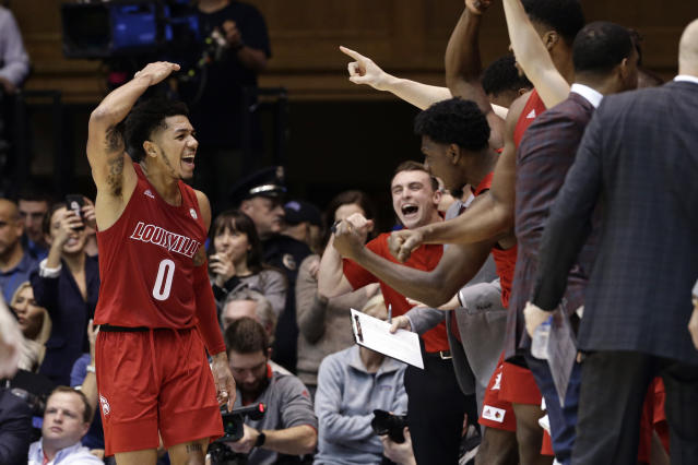 Louisville guard Lamarr Kimble (0) celebrates with the bench at the end of the team's NCAA college basketball game against Duke in Durham, N.C., Saturday, Jan. 18, 2020. Louisville won 79-73. (AP Photo/Gerry Broome)