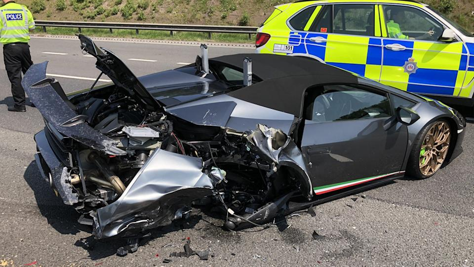 A 20 minute old brand new Lamborghini that stopped due to mechanical failure was hit from behind.