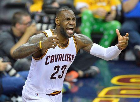 May 25, 2016; Cleveland, OH, USA; Cleveland Cavaliers forward LeBron James (23) reacts in the third quarter against the Toronto Raptors in game five of the Eastern conference finals of the NBA Playoffs at Quicken Loans Arena. Mandatory Credit: David Richard-USA TODAY Sports