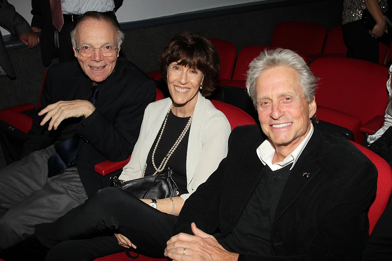 """In this photo provided by StarPix, from left to right, Nick Pileggi, Nora Ephron and Michael Douglas attend the HBO films premiere of """"Too Big To Fail"""" Monday, May 16, 2011 in New York."""