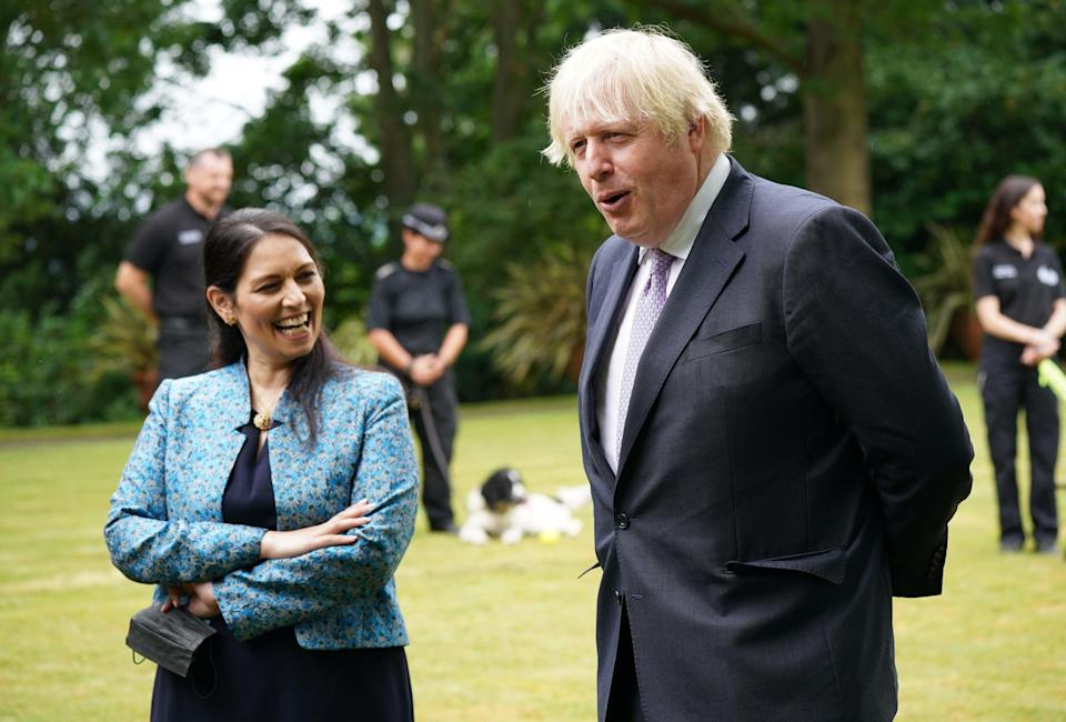 Boris Johnson and Priti Patel during a visit to Surrey Police headquarters on Tuesday (PA)