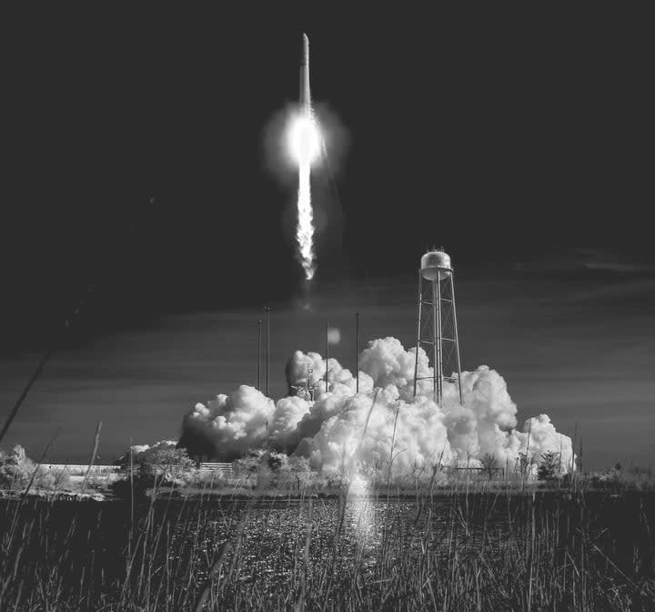 The Northrop Grumman Antares rocket, with Cygnus resupply spacecraft onboard, is seen in this black and white infrared photograph as it launches from Pad-0A, Wednesday, April 17, 2019 at NASA's Wallops Flight Facility in Virginia.