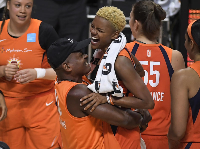 Connecticut Sun's Courtney Williams is lifted by her father Don Williams at the end of Game 2 of a WNBA basketball playoff game against the Los Angeles Sparks, Thursday, Sept. 19, 2019, in Uncasville, Conn. (AP Photo/Jessica Hill)