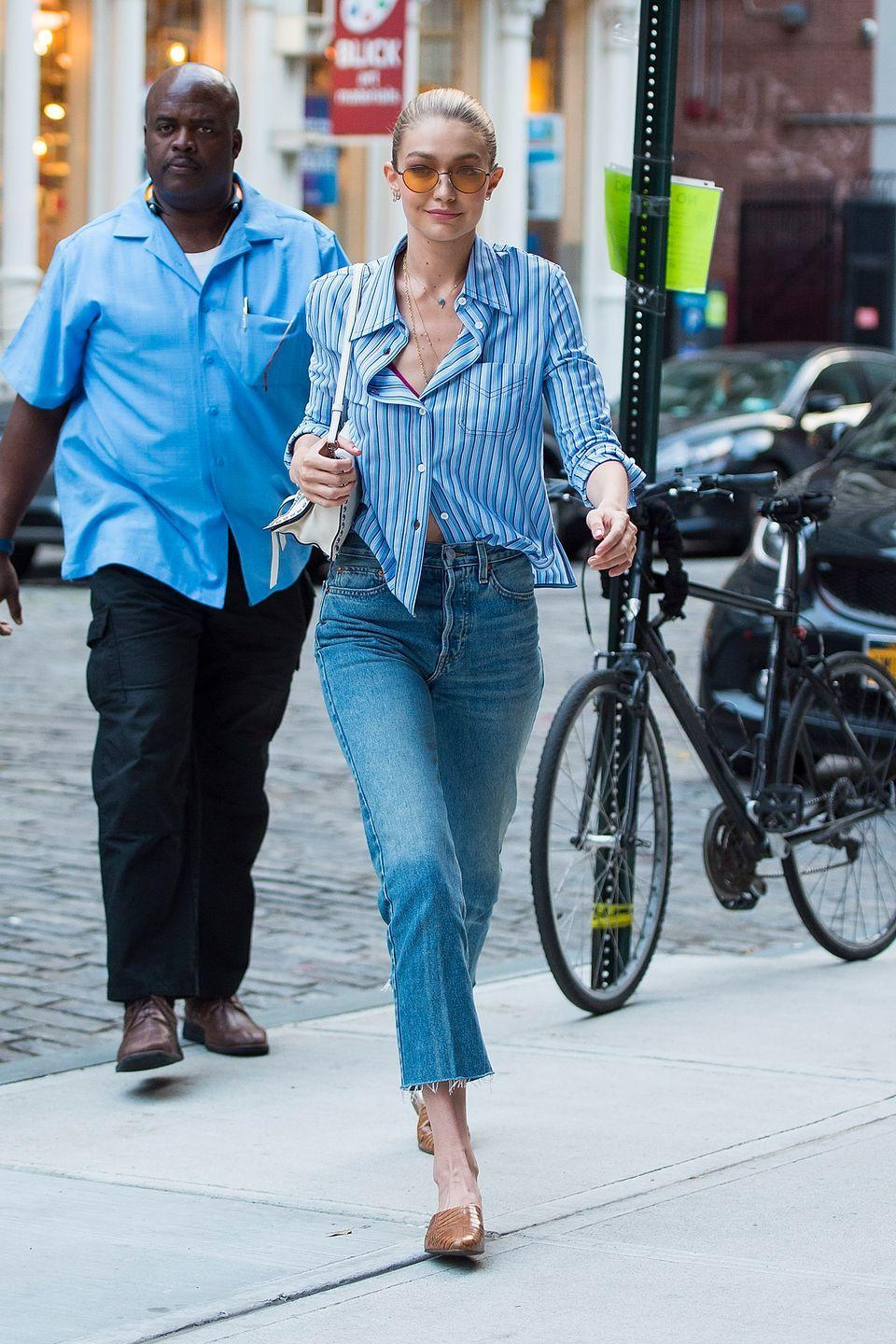 <p>Laid-back button-ups are Gigi's specialty, which is great for anyone trying to steal her style. Dupe this look with cropped jeans of your own – and if you don't have any, just chop those old flares you never wear. </p>