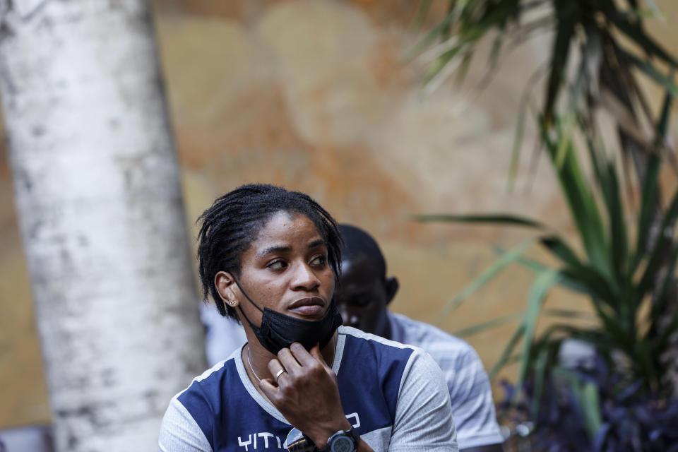 Freestyle wrestler Fatoumata Yarie Camara, of Guinea, waits to receive the COVID-19 vaccine at the Santo Spirito hospital in Rome, Saturday, July 3, 2021. A West African wrestler's dream of competing in the Olympics has come down to a plane ticket. Fatoumata Yarie Camara is the only Guinean athlete to qualify for these Games. She was ready for Tokyo, but confusion over travel reigned for weeks. The 25-year-old and her family can't afford it. Guinean officials promised a ticket, but at the last minute announced a withdrawal from the Olympics over COVID-19 concerns. Under international pressure, Guinea reversed its decision. (AP Photo/Riccardo De Luca)