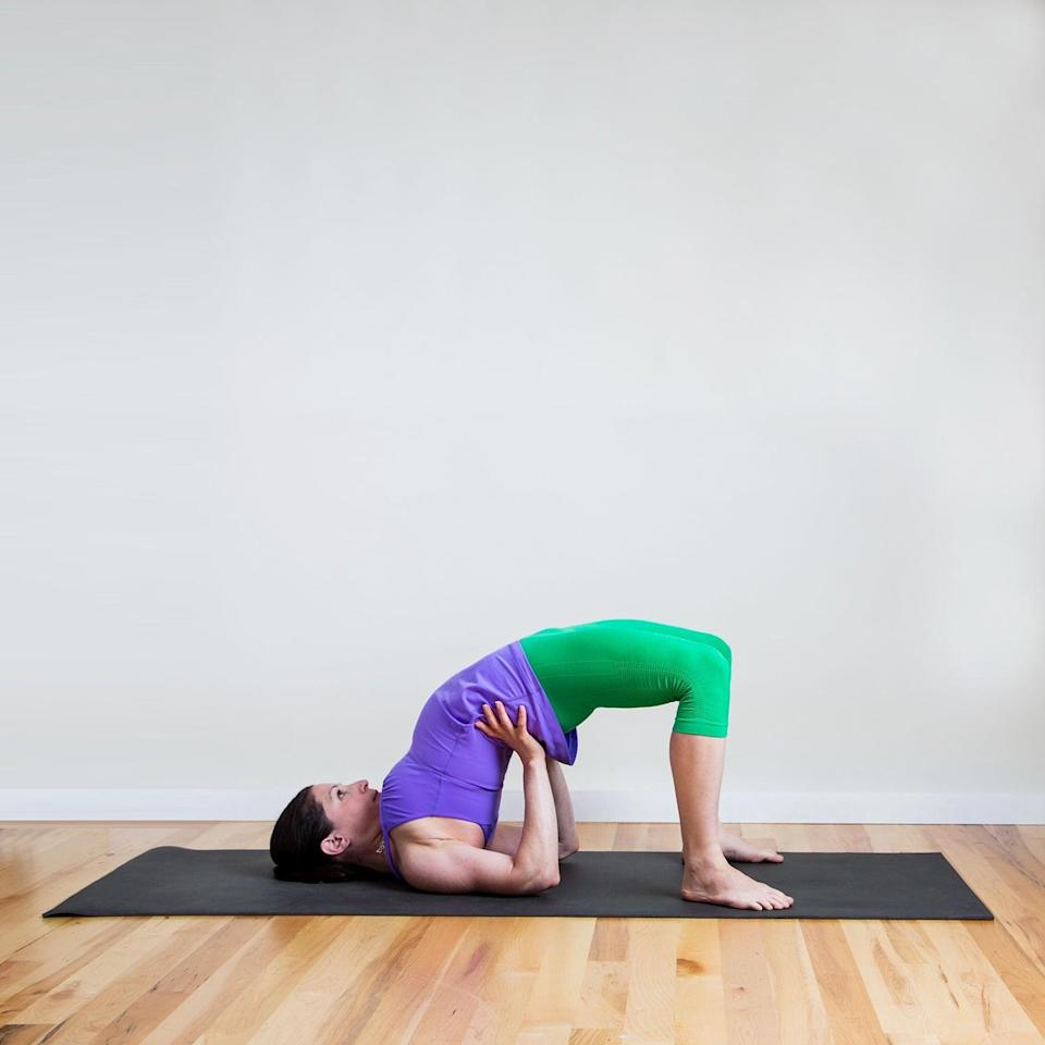 "<p><strong>Sanskrit Name:</strong> Setu Bandha Sarvangasana </p> <p><strong>English Translation:</strong> Bridge Pose </p> <p><strong>Also Called:</strong> Half Wheel </p> <ul> <li>Begin lying flat on your back with your arms along the sides of your body, with your palms facing down. Bend your knees, placing your heels as close as you can to your bum.</li> <li>With your palms and feet pressing firmly into the ground, lift your hips up. Keep your palms on the mat or clasp your hands together below your pelvis, extending through your arms. Or you can also bend your elbows and rest your hands on your lower back. If your feet are close enough, you can also hold your ankles. </li> <li>Stay here for five deep breaths, lifting your hips up as high as you can.</li> </ul> <p>If you want more <a href=""http://www.fitsugar.com/Strike-Yoga-Pose-Half-Wheel-578824"" class=""link rapid-noclick-resp"" rel=""nofollow noopener"" target=""_blank"" data-ylk=""slk:details on how to do Bridge Pose, keep reading"">details on how to do Bridge Pose, keep reading</a>. </p>"