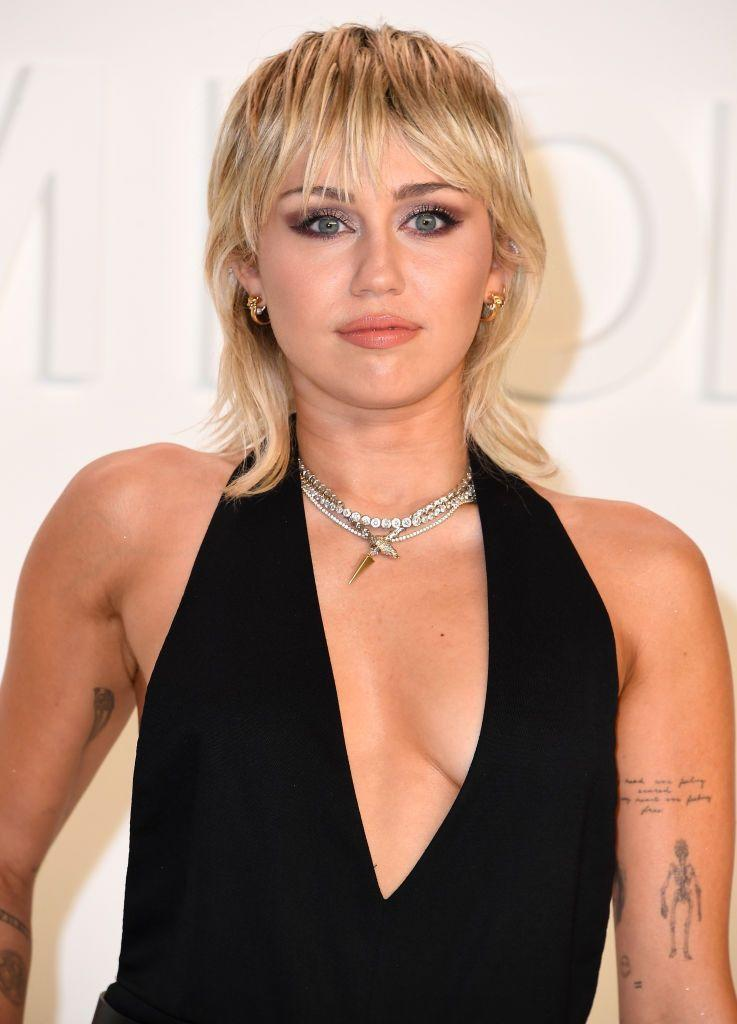"""<p>Miley loves her sign so much that <a href=""""https://genius.com/Miley-cyrus-sagittarius-lyrics"""" rel=""""nofollow noopener"""" target=""""_blank"""" data-ylk=""""slk:she even named a song after it"""" class=""""link rapid-noclick-resp"""">she even named a song after it</a>.</p>"""