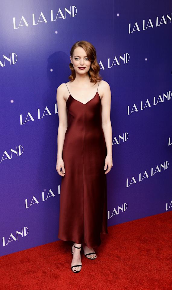 <p>At a screening of 'La La Land', Emma worked one of her best looks to date: a slinky slip dress that offset her complexion and hair colour beautifully. [Photo: Getty] </p>