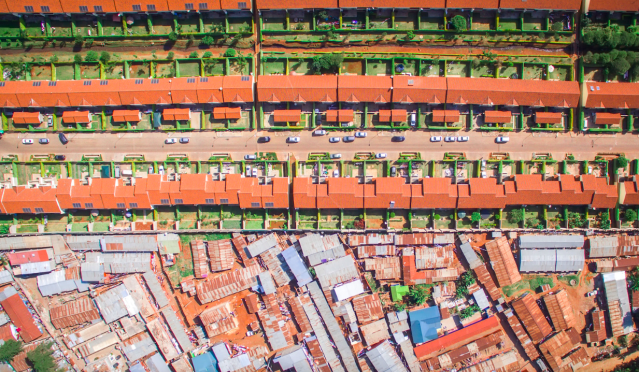 <p>Uniformity on the top half of this picture is replaced by tightly-packed shacks (MediaDrumWorld/Johnny Miller) </p>