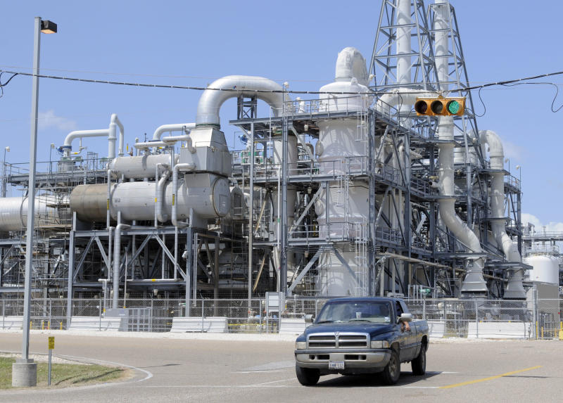 FILE -In this Thursday, Sept. 11, 2008, file photo, a truck leaves the Dow Chemical plant in Freeport, Texas. The Dow Chemical Co. reports quarterly financial results before the market opens on Thursday, April 25, 2013. (AP Photo/Pat Sullivan, File)