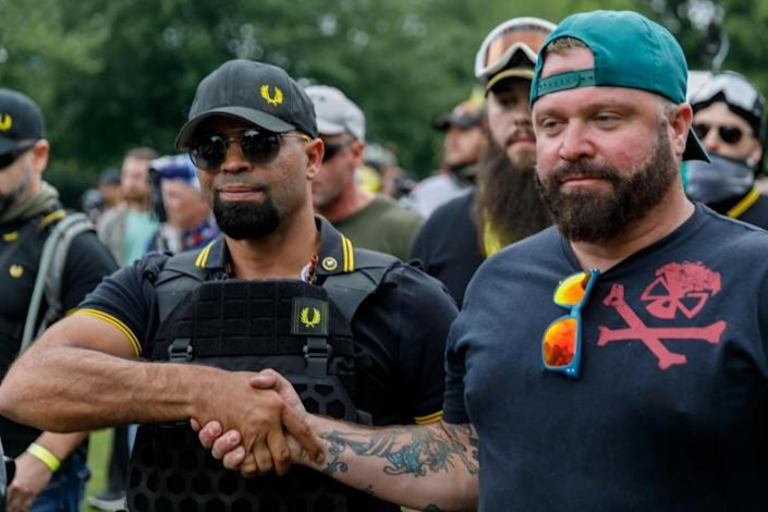 Enrique Tarrio (L), a member of the all-male 'Proud Boys' organization, which has been designated a hate group by the Southern Poverty Law Center, is due to attend (AFP Photo/John Rudoff)