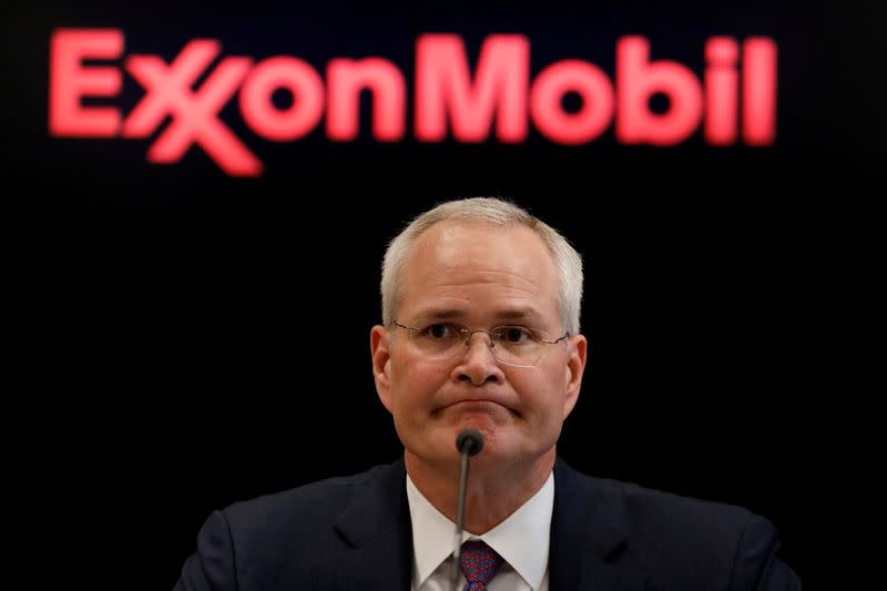 FILE PHOTO: Darren Woods, Chairman & CEO of Exxon Mobil Corporation speaks during a news conference at the NYSE