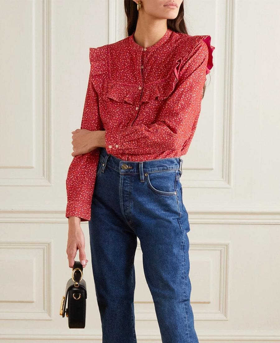 """A put-together look doesn't have to require much effort. Enter this Lauren Hutton, 70s-inspired ruffle blouse. The easy-breezy cotton is perfect for warmer temps, and the long-sleeves play well with any fall looks you may be planning. $178, Net-a-Porter. <a href=""""https://www.net-a-porter.com/en-us/shop/product/doen/austen-ruffled-floral-print-cotton-corduroy-blouse/1230435"""" rel=""""nofollow noopener"""" target=""""_blank"""" data-ylk=""""slk:Get it now!"""" class=""""link rapid-noclick-resp"""">Get it now!</a>"""