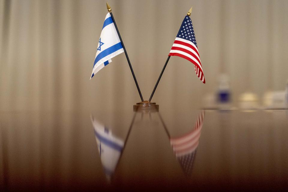 Israeli and American flags are visible on the table as Secretary of Defense Lloyd Austin hosts a bilateral meeting with Israeli Defense Minister Benny Gantz at the Pentagon in Washington, Thursday, June 3, 2021. (AP Photo/Andrew Harnik)