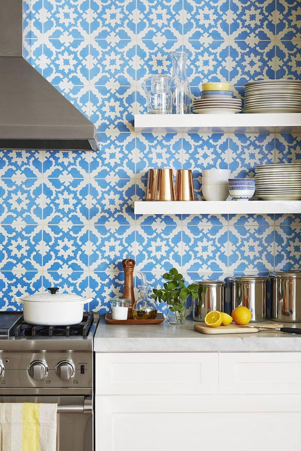 <p>A playful backsplash pattern, boasting a blue-and-white palette, steals the show in this kitchen.</p>