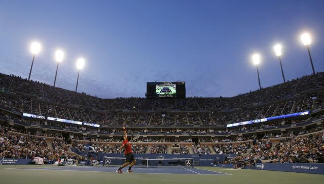 Novak Djokovic of Serbia serves to Rafael Nadal of Spain during their men's final match at the U.S. Open tennis championships in New York, September 9, 2013. REUTERS/Ray Stubblebine (UNITED STATES - Tags: SPORT TENNIS)