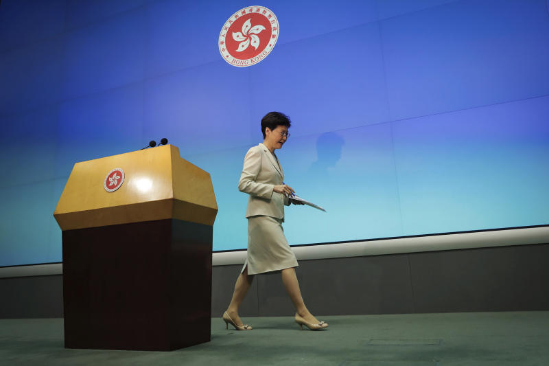 FILE - In this Tuesday, June 18, 2019, file photo, Hong Kong Chief Executive Carrie Lam leaves after a press conference at the Legislative Council in Hong Kong. Many analysts expect Lam will eventually step down to take responsibility for the mess resulting from her effort to fast-track the extradition bill, which would allow some suspects in Hong Kong to be tried in mainland Chinese courts. (AP Photo/Kin Cheung, File)