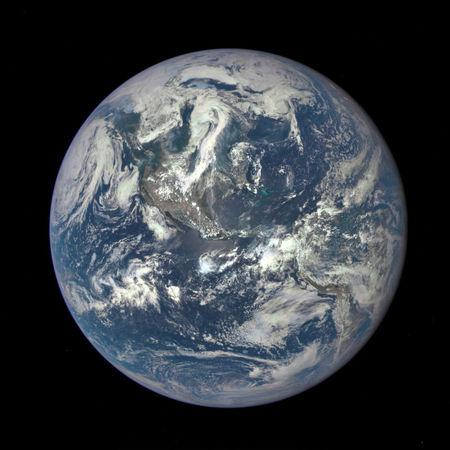 FILE PHOTO: This color image of Earth, taken by NASA's Earth Polychromatic Imaging Camera (EPIC), a four megapixel CCD camera and telescope on July 6, 2015, and released on July 20, 2015.   REUTERS/NASA/Handout via Reuters/File Photo