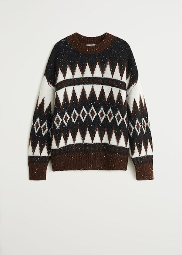 """Take note: This Mango sweater would look great with a pair of leather pants. $80, Mango. <a href=""""https://shop.mango.com/us/women/cardigans-and-sweaters-sweaters/knit-paillette-sweater_57028256.html?c=30&n=1&s=prendas_she.familia;55,355,610,810"""">Get it now!</a>"""