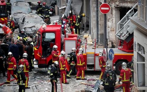 Firemen work at the site of an explosion in a bakery shop in the 9th District in Paris - Credit: Reuters