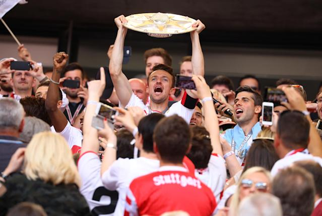 Football Soccer - VfB Stuttgart v Wurzburger Kickers - 2. Bundesliga - Mercedes-Benz Arena, Stuttgart, Germany - 21/5/17 VfB Stuttgart's Christian Gentner, team mates and fans celebrate promotion with the trophy Reuters / Kai Pfaffenbach Livepic DFL RULES TO LIMIT THE ONLINE USAGE DURING MATCH TIME TO 15 PICTURES PER GAME. IMAGE SEQUENCES TO SIMULATE VIDEO IS NOT ALLOWED AT ANY TIME. FOR FURTHER QUERIES PLEASE CONTACT DFL DIRECTLY AT + 49 69 650050.