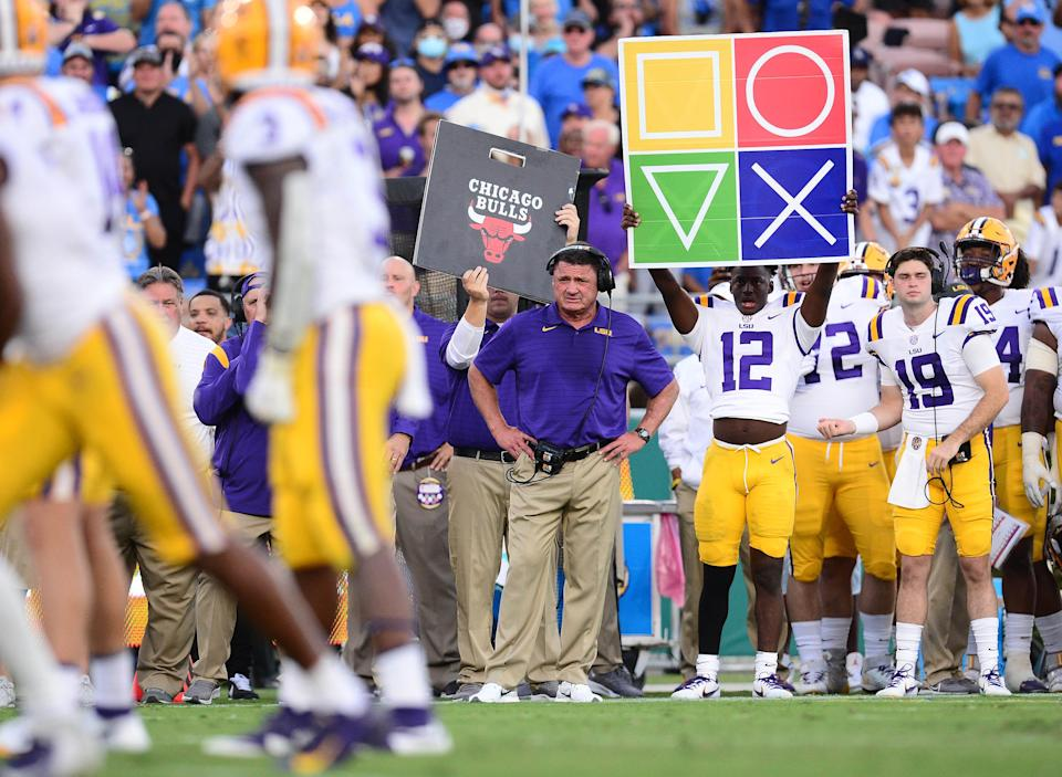 LSU head coach Ed Orgeron watches game action during the first half of the Tigers' loss against UCLA.