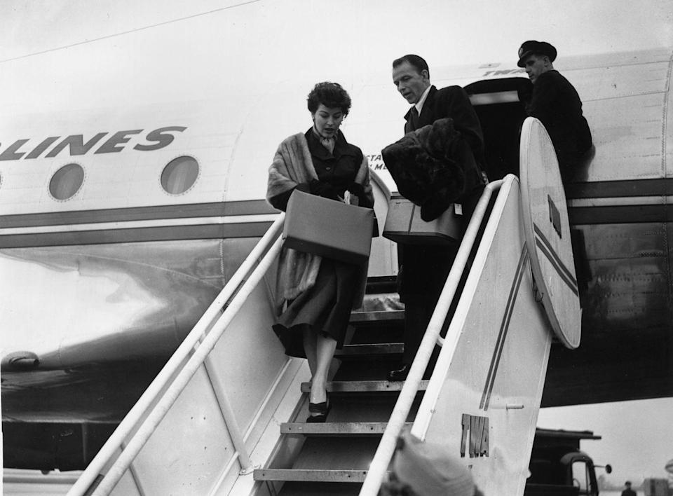 "<p>American singer Frank Sinatra and actress Ava Gardner arriving at a London Airport on vacation.</p><p>Other celebrity visitors this year: <span class=""redactor-invisible-space"">Charlie Chaplin<br></span></p>"