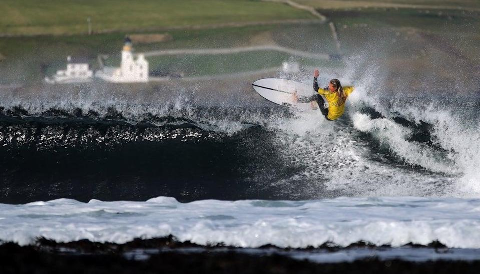 Wave Rider, taken at Thurso by James Gunn was highly commended in the People and Recreation category (James Gunn/PA) (PA Media)
