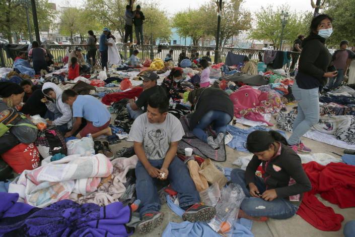 Central American migrants who managed to cross illegally into the U.S. in order to seek asylum, stay under a park gazebo after they were sent back to Mexico by U.S. border authorities in Reynosa, Mexico Friday, March 26, 2021. The migrants claimed that they were expelled back to Mexico in the middle of the night two days ago without any legal proceedings. (AP Photo/Dario Lopez-MIlls)