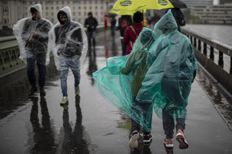 Members of the public walk through torrential rain on Westminster Bridge on August 14, 2019 in London: Getty Images