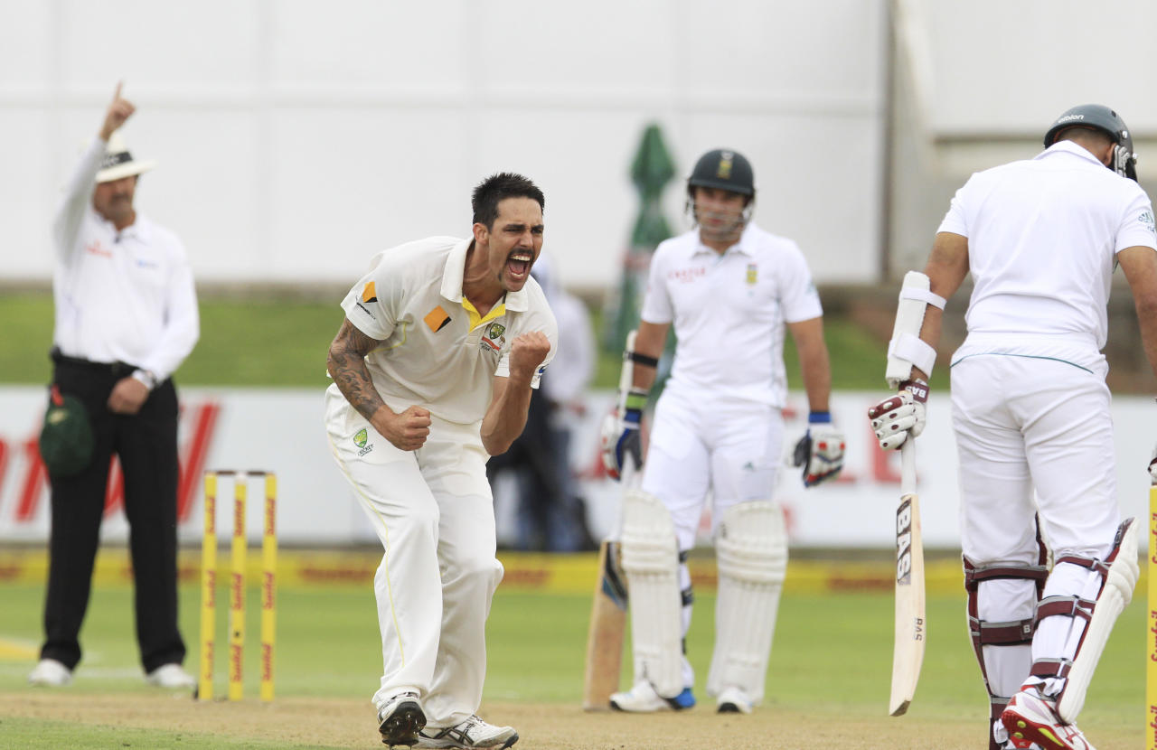 Australia's bowler Mitchell Johnson, second from left, reacts as umpire Richard Illingworth of England, left, signals a fall of wicket for South Africa's batsman Hashim Amla, right, on LBW for a duck during first day of their 2nd cricket test match at St George's Park in Port Elizabeth, South Africa, Thursday, Feb. 20, 2014. (AP Photo/ Themba Hadebe)