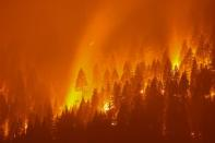 FILE PHOTO: The Dixie Fire, California's largest active fire burns at night in Taylorsville