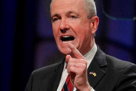 FILE PHOTO: New Jersey Governor Phil Murphy speaks after taking the oath of office in Trenton, New Jersey