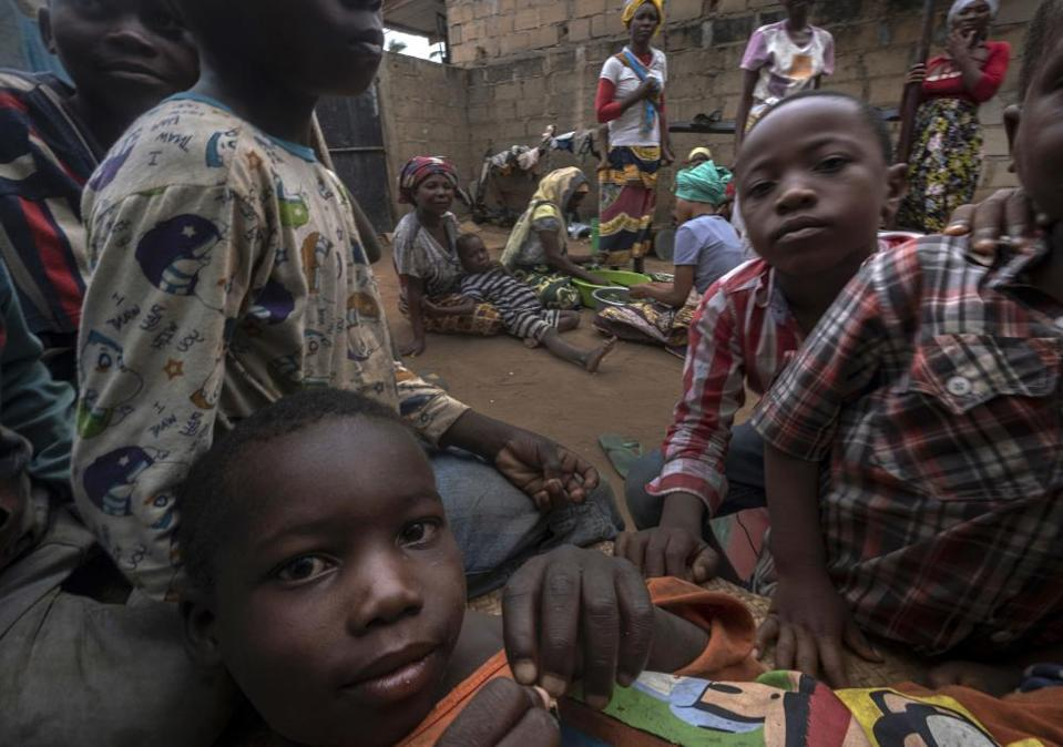 Displaced women with their children shelter in Pemba after fleeing attacks in Palma.