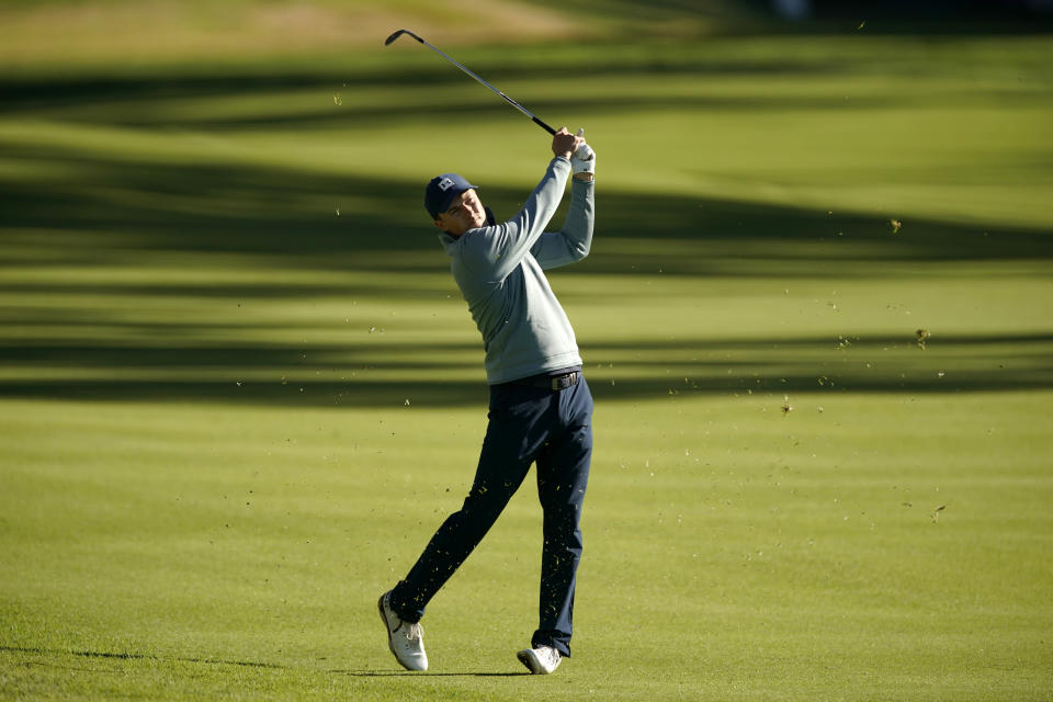 Jordan Spieth hits his second shot on the 13th hole during the second round of the Genesis Invitational golf tournament at Riviera Country Club, Friday, Feb. 19, 2021, in the Pacific Palisades area of Los Angeles. (AP Photo/Ryan Kang)